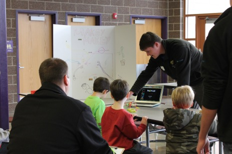 Michael works with students to explain the MakeyMakey.